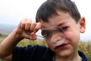 boy-magnifying-glass